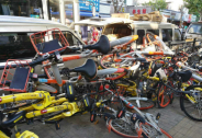 共享单车推出违停扣费就能解决乱停放问题?